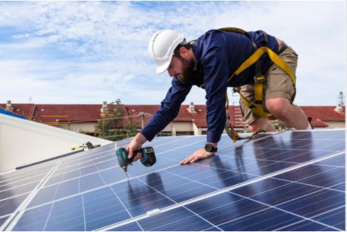 Solar Panels Cost - Man Installing Solar Panels